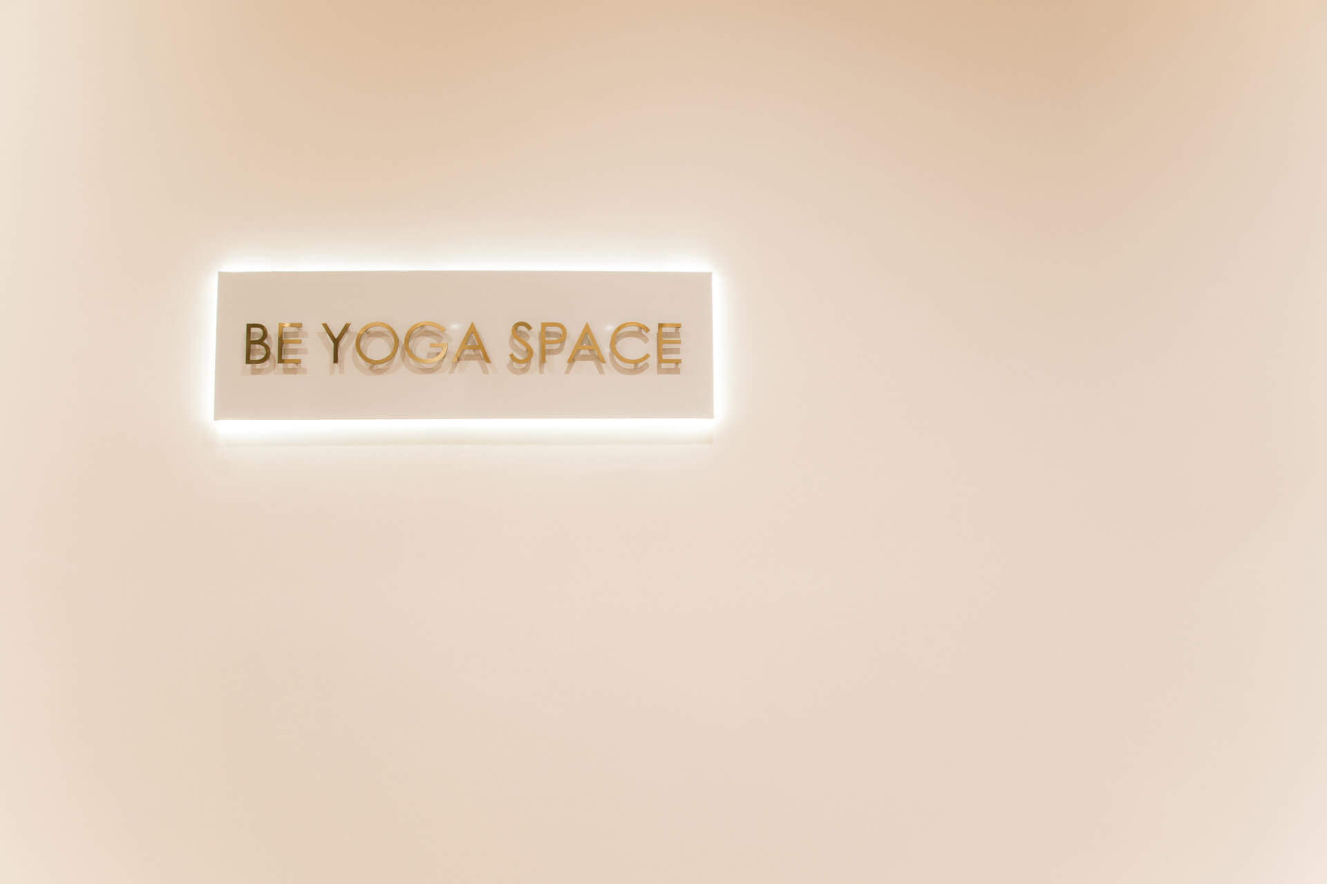 Be Yoga Space sign on white wall