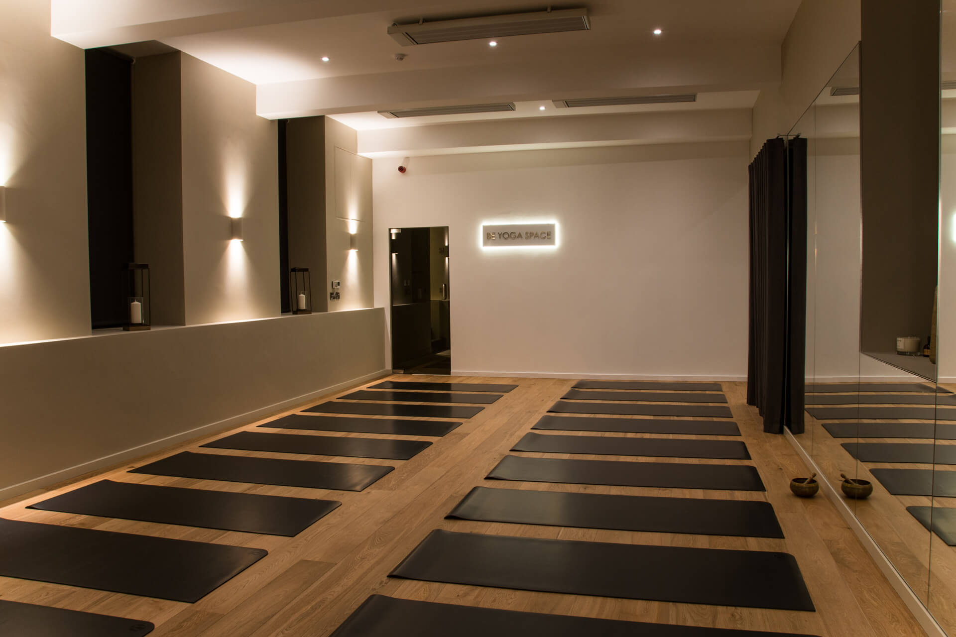 Be Yoga Space full hot yoga studio view dimmed lights